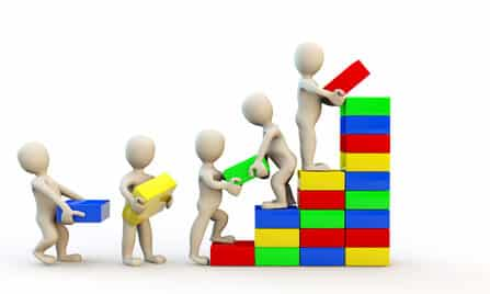 Grow your Business - team packing blocks